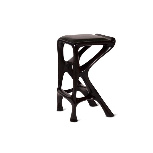 "Barstool designed by Amorph made out of solid ash wood and leather. Stain color: walnut Dimension 31"" H x 19.50"" L x 15"" W..."