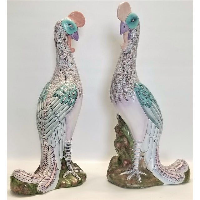 Offering a rare EXTRA-large pair of vintage Chinese porcelain phoenix birds. Both birds are glorious in color and form and...