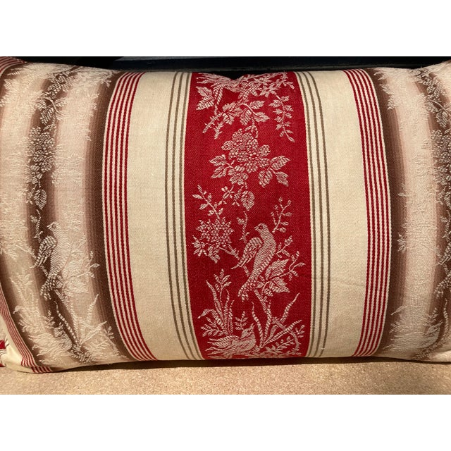 A newly crafted pillow made from a circa 1880s red, cream and pale brown ticking stripe woven cotton. A down insert is...