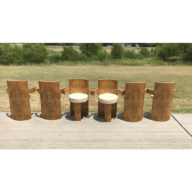 A rare six-piece set of sculptural Art Deco petite french modernist chairs in sycamore or olive burl wood veneer. Covered...