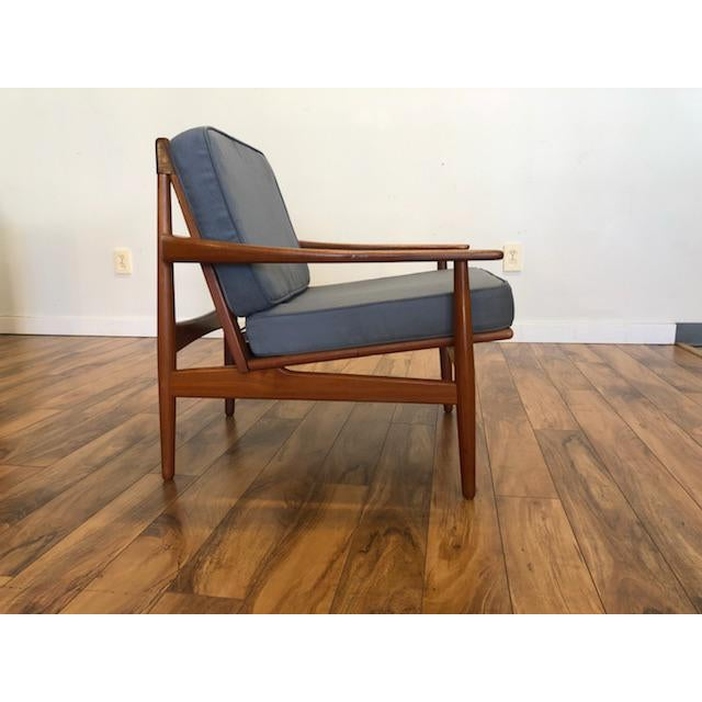 Gorgeous vintage teak frame lounge chair designed by Grete Jalk and made in Denmark circa 1960's. Like all of her work,...