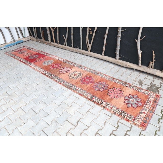 Vintage Turkish Hand-Knotted Long Runner Rug is a semi-antique vintage rug. '60s Eastern region of Turkey's unique rug is...