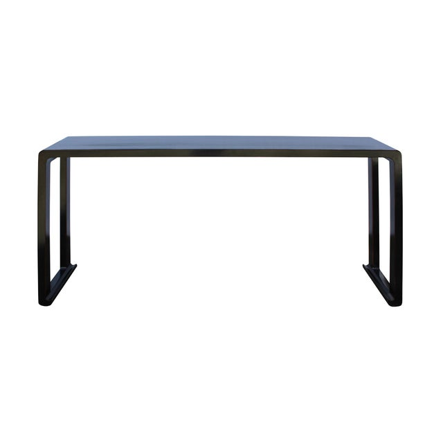 This is a long oriental alter console table with a simple plain body with straight open panel scroll leg design. The...