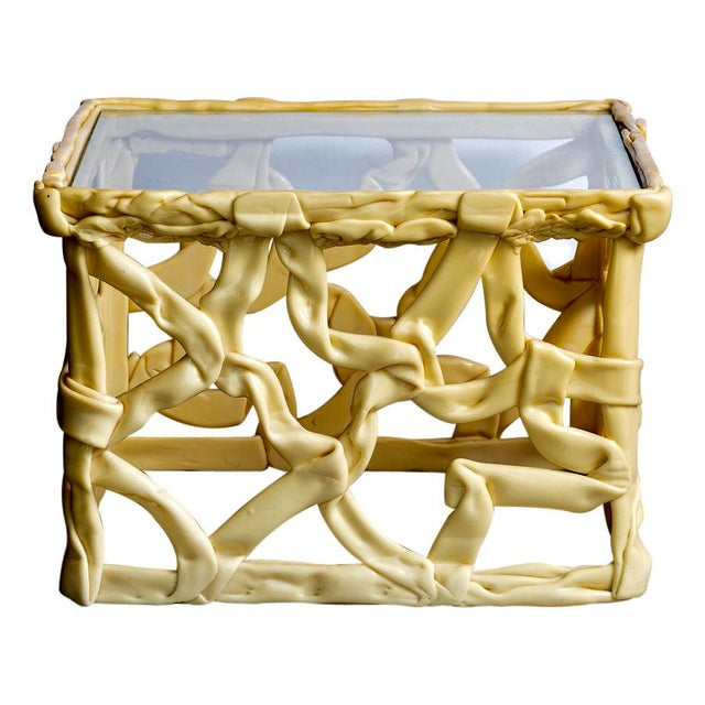 The twisted and interwoven strands of Yellow resin gives these tables a very modern chic. Great and unusual accent pieces....