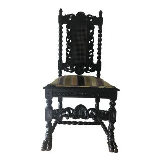 Early 1900s Spanish Revival Carved Chair With Velvet Upholstery