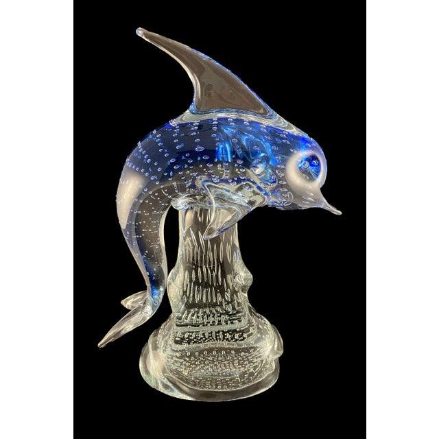 Beautiful cobalt blue controlled bubble art glass sculpture of a dolphin riding a wave. This is a quality piece and weighs...