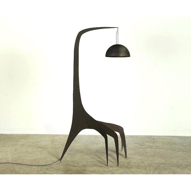 Sculptural form meets function in the Kinetic Floor Lamp. Cut from solid, 12 gauge blackened sheet-steel with a solid...