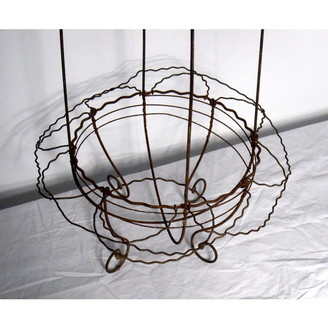 This 19th Century French crinkle-wire basket can be hung or can sit on a surface. Great for trailing plants indoors or...