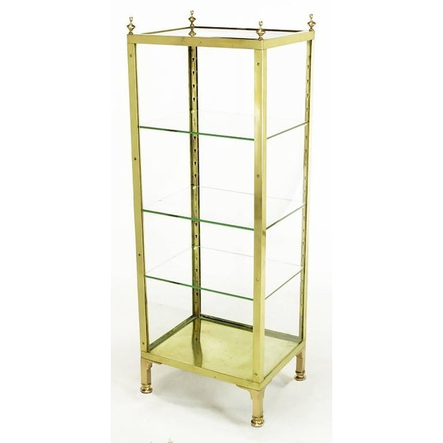 1930s medical or dental glass and brass case. Freshly polished brass frame with bracketed brass legs and top brass...