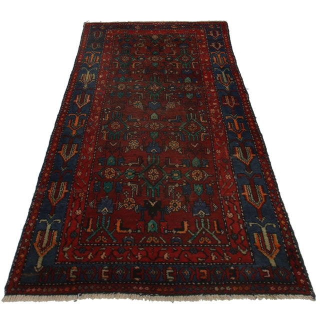 This Persian Hamedan Rug is crafted of hand-knotted wool woven into a geometric pattern.