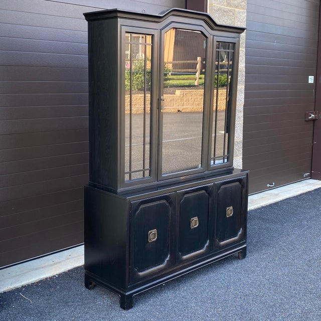 Top quality all solid oak two piece china closet by Davis Cabinet Company of Tennessee. Upper section has three adjustable...
