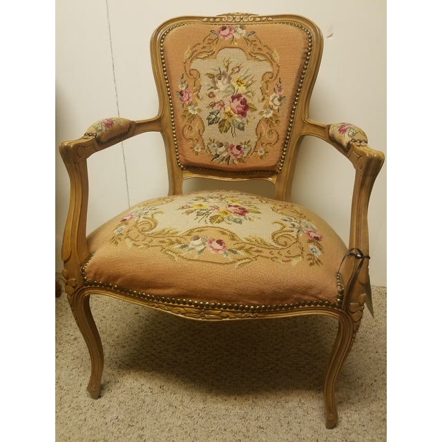 This French arm chair is in exquisite condition the color is a lite peach the upper backing of the chair is done in peach...