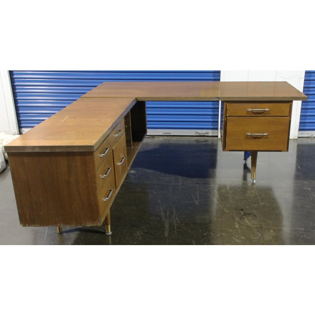 Large L-shaped executive secretary desk that could also function as a reception area desk. Classic clean, severe lines of...