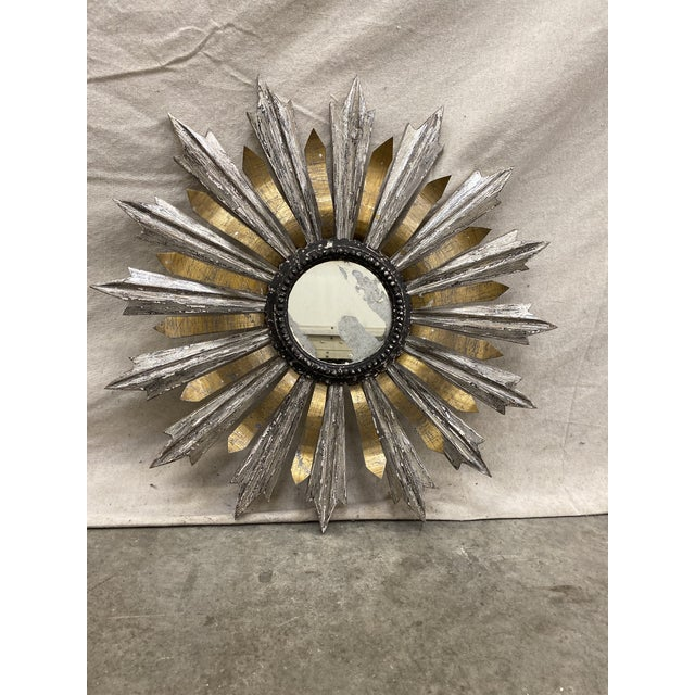 Italian sunburst, with carved wood sun rays having a silver gray weathered patina, along with a second layer of metal...