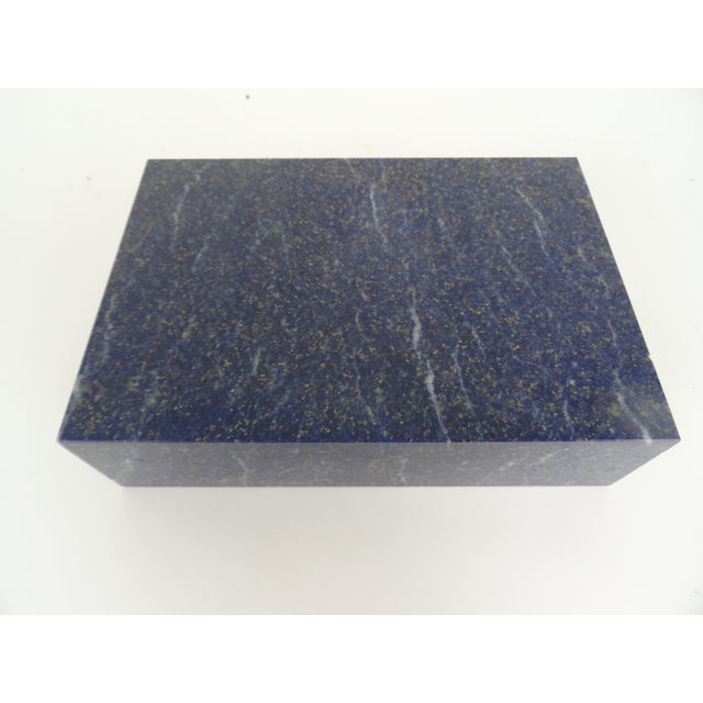 Italian Lapis Lazuli box, naturally colored stone with Vermeil hinging and felt interior. Made in the 1970s.