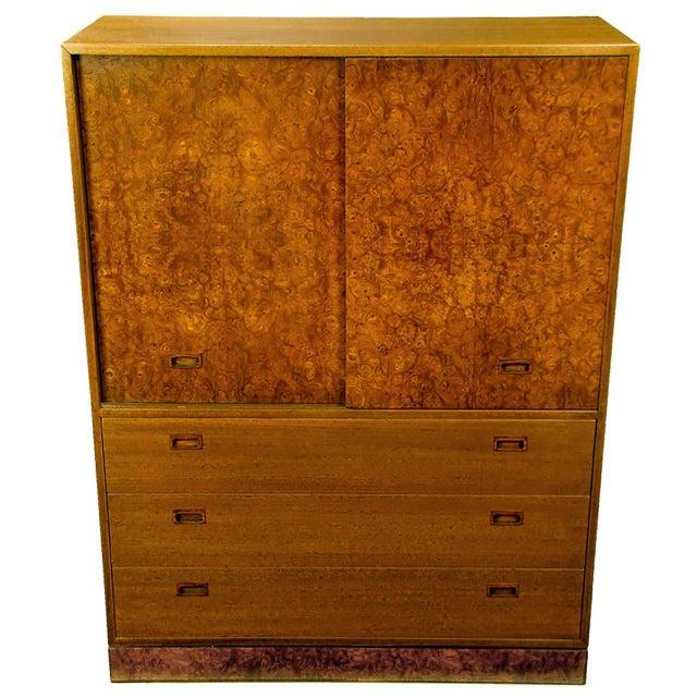 This sleek clean lined Harvey Probber gentleman's bureau features burl wood doors with recessed rosewood pulls. The doors...