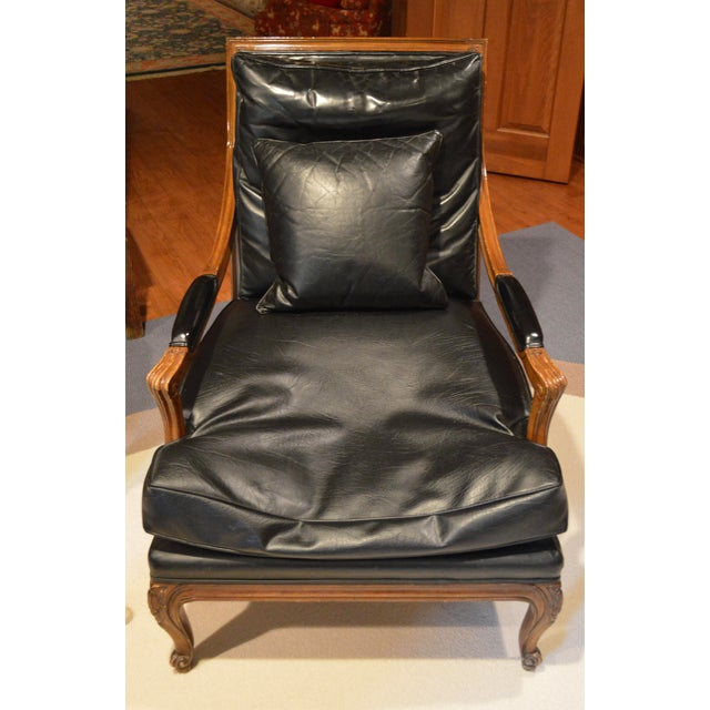 Great vintage style bergere with detailed carvings and an updated leather upholstery for a modern feel.