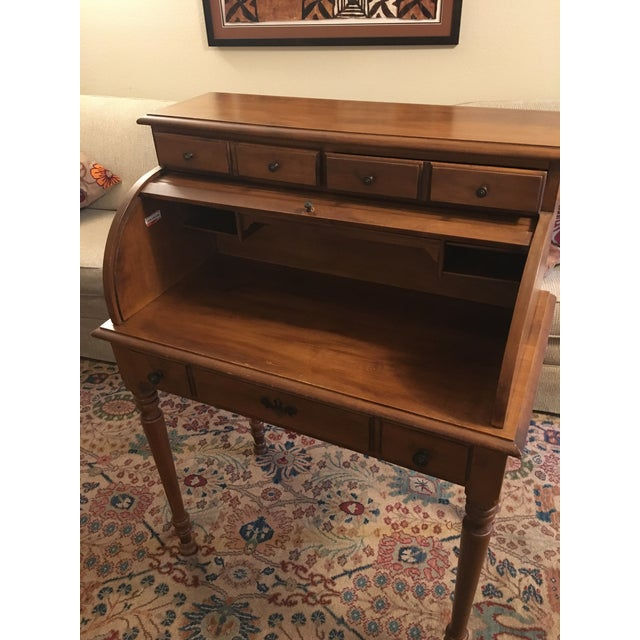 Charming hard rock maple roll-top secretary desk, made by the Tell City Chair Company in northern Indiana, under the name...