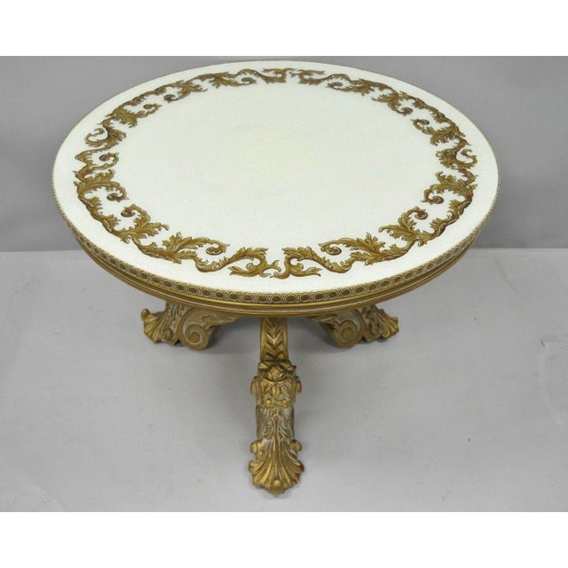 Antique French Rococo/Baroque style coffee table. Item features solid wood carved pedestal base, gold gilt hand painted...