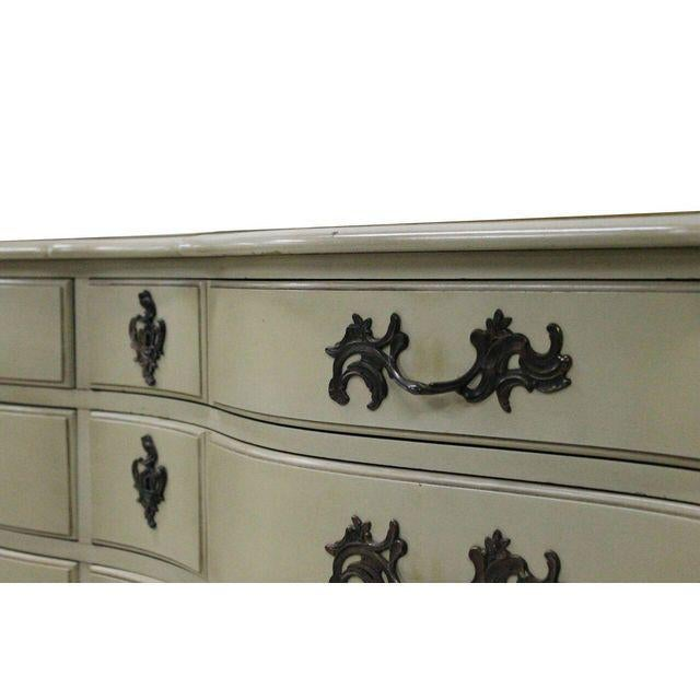 French Provincial dresser Cream painted with gold gilt accents , fancy brass hardware . Appears to be 12 drawers but is...