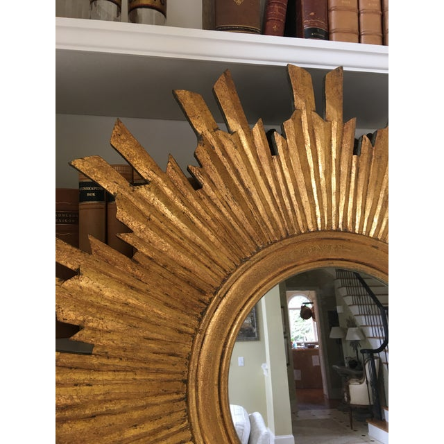 """Wonderful 35"""" gilt wood sunburst mirror. Beautiful and bright gilted bursts spreading from the round mirror. The back is..."""