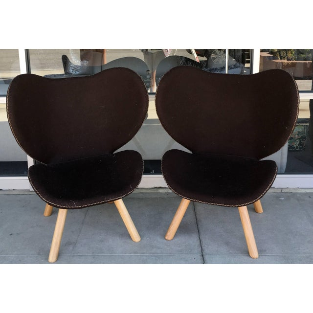 These chairs were Mid-Century designed in Denmark, but made recently on awesome dark brown wool with hand stitching...