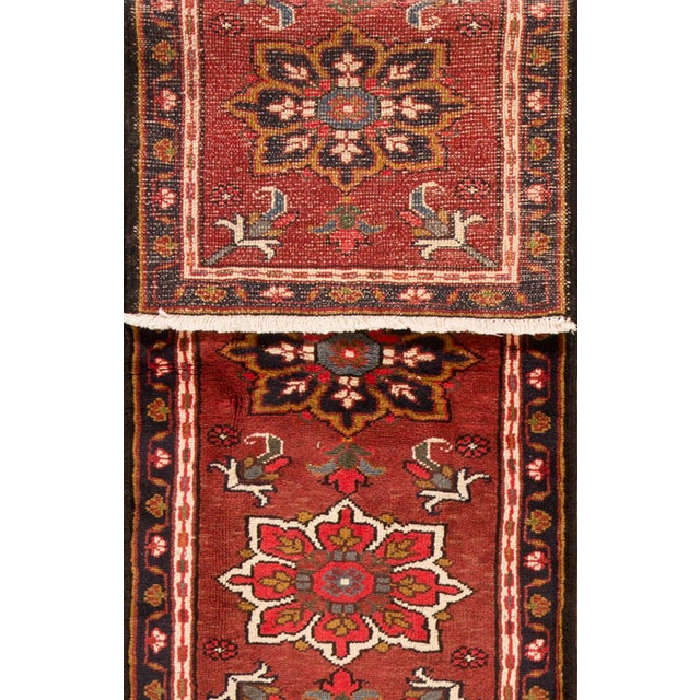 Vintage hand-knotted Persian Heriz rug with a floral design. This piece has great detailing and great colors. It would be...