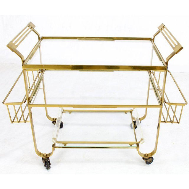 Mid-Century Modern Art Deco solid brass and glass bar cart. Outstanding clockwork quality craftsmanship.