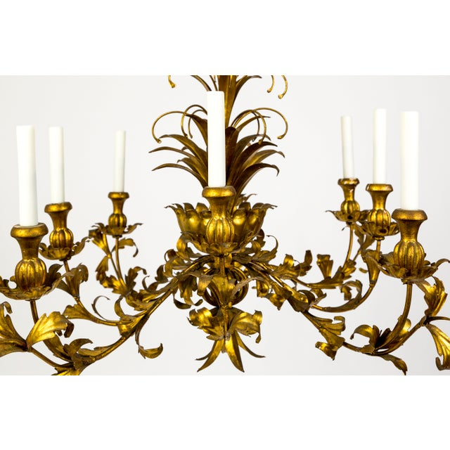 We have two of these opulent, gilt metal, Hollywood Regency chandeliers. The finish has a rich, gleaming tone, and the...