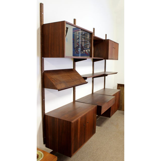 For your consideration is a striking Danish Poul Cadovious Cado walnut wood bookcase wall unit, with several compartments,...