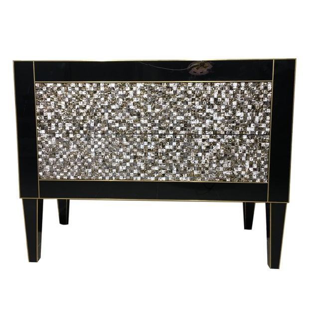 About 21st century handmade mirrored commode or chest of drawers in Murano glass and brass inlay with two drawers. The...