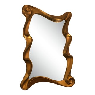 1980's Curved and Flowing Gilt Gold Mirror For Sale