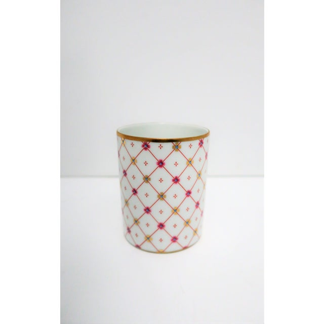 A beautiful Italian white and gold porcelain bathroom water cup or vanity piece to hold Q-tips, make-up brushes, etc., by...