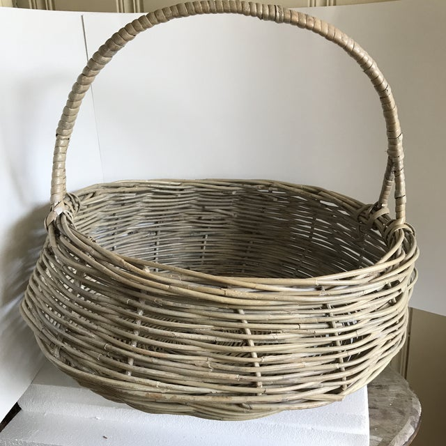 Very large earthy wood natural woven storage vessel for throws or firewood. Leans a little to one side but once filled...