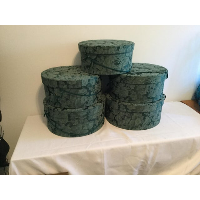"""5 Fabric covered hat boxes: 2 hat boxes 15 1/2"""" wide, 7"""" tall 2. hat boxes 14 1/2"""" wide, 6 1/2""""tall 1. Hat box 13 1/2""""..."""