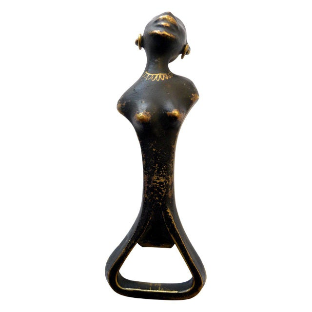 Black patinated brass bottle opener in the shape of an African woman attributed to Richard Rohac. Unsigned.