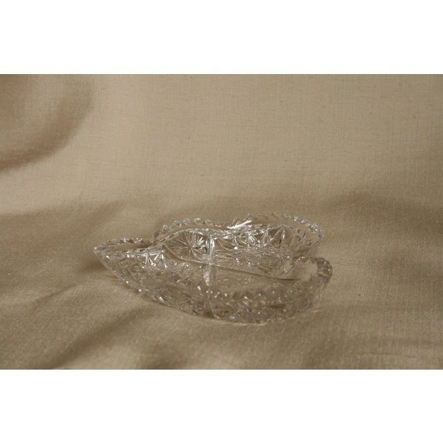 This vintage heart-shaped lead crystal ashtray has a beautiful deep-etched design and four indentations on the sides of...