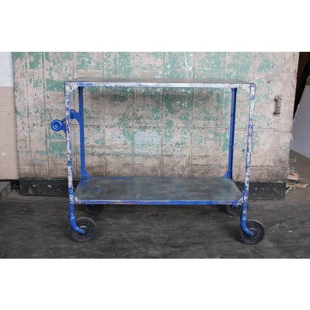 Vintage American metal bar cart with two glass shelves. This piece would look great in an industrial room setting.