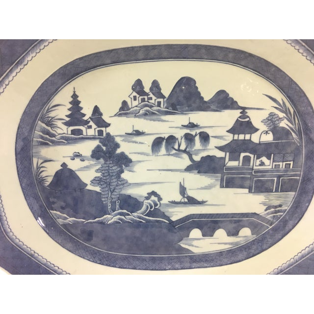 This large Canton platter dates from the 1830's and is in stunning condition. Light wear to the glaze around the edges.