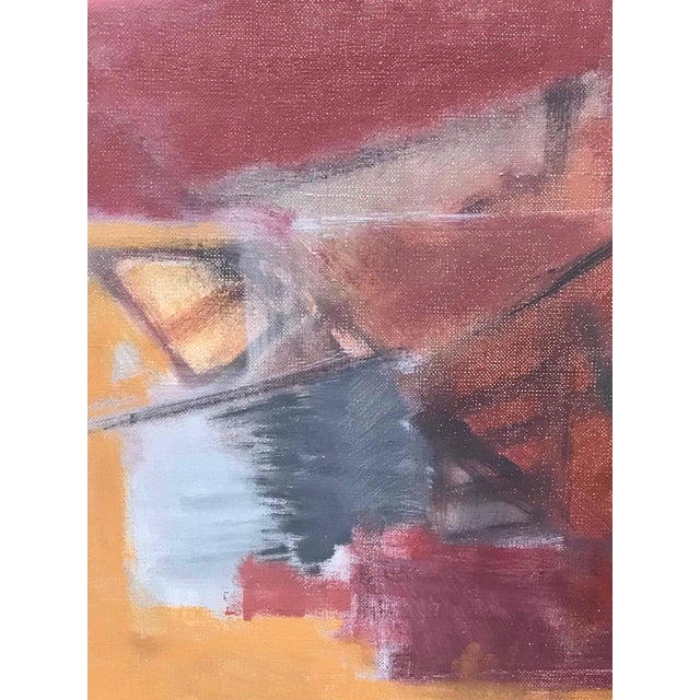 A red and yellow abstract painting on canvas.