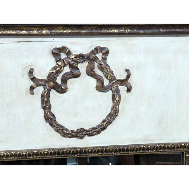 "Neoclassical style mirror with gilt decor. Mirror size: 32"" x 22.5""."
