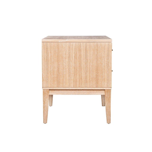 Cerused oak two-drawer nightstands on apron frame base detailed with solid brass drawer pulls. Solid maple drawer boxes...