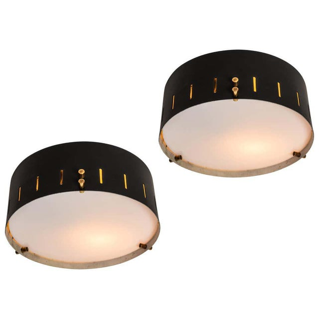 1960s Bruno Gatta wall or ceiling light for Stilnovo. Executed in black painted metal with opaline glass and brass...