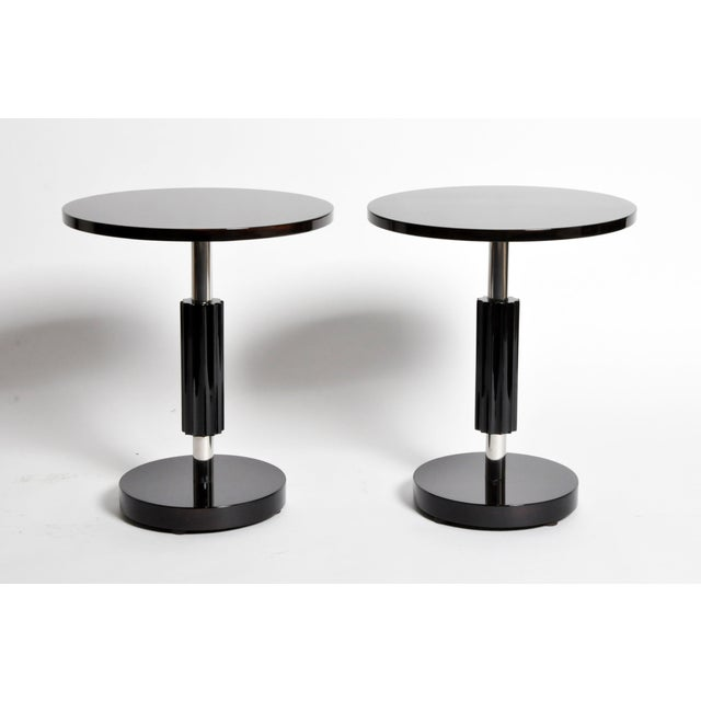 These simple yet elegant Art Deco style round tables are from Hungary and are made from walnut veneer.