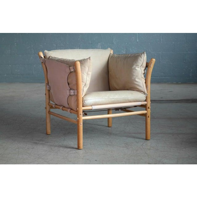 Beautiful 1960s safari chair in cream and tan leather and blond beech wood designed by Arne Norell in the 1960s for Norell...