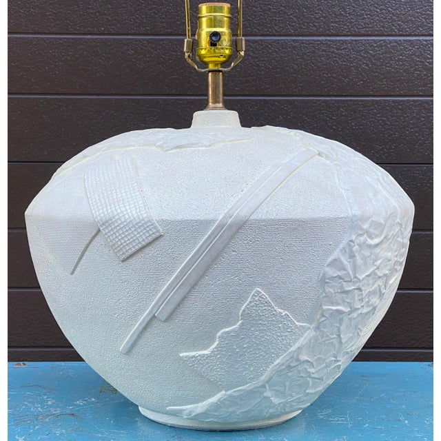"""A totally awesome plaster table lamp featuring a bulbous base with an abstract raised design. Signed """"Bon Art 1987""""."""