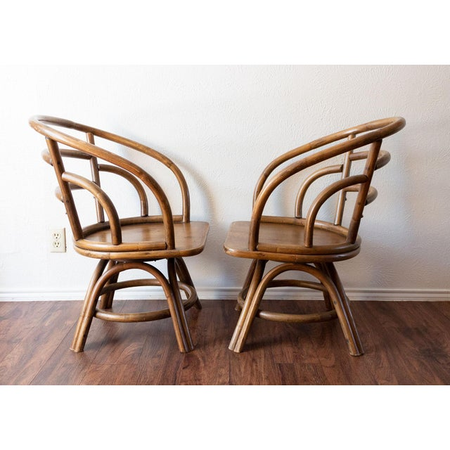 Two beautiful Brown Jordan chairs in warm natural rattan. Both swivel 90 degrees left and right, They have been well loved...