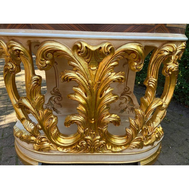 A handmade table made in Italian Baroque/Rococo style. Made in heavy quality solid handcrafted wood with a gild layer of...