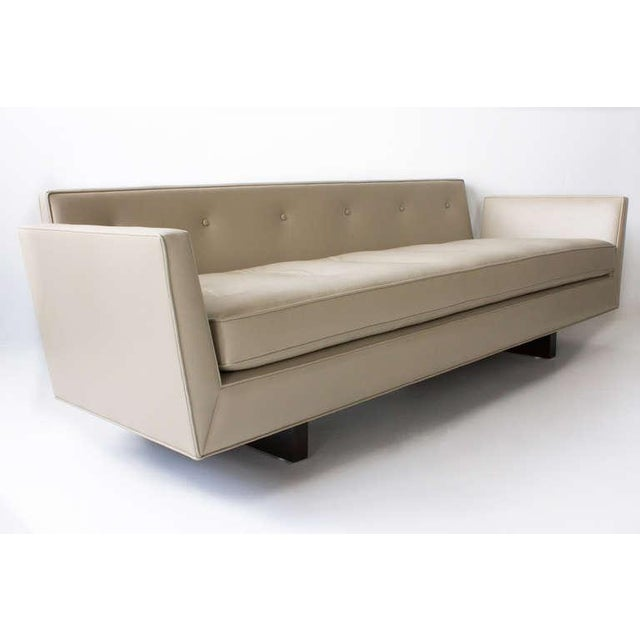 Open arm sofa by Edward Wormley for Dunbar USA, circa 1950s. Leather, stained mahogany. Measures: 90 W x 32 D x 28 H...