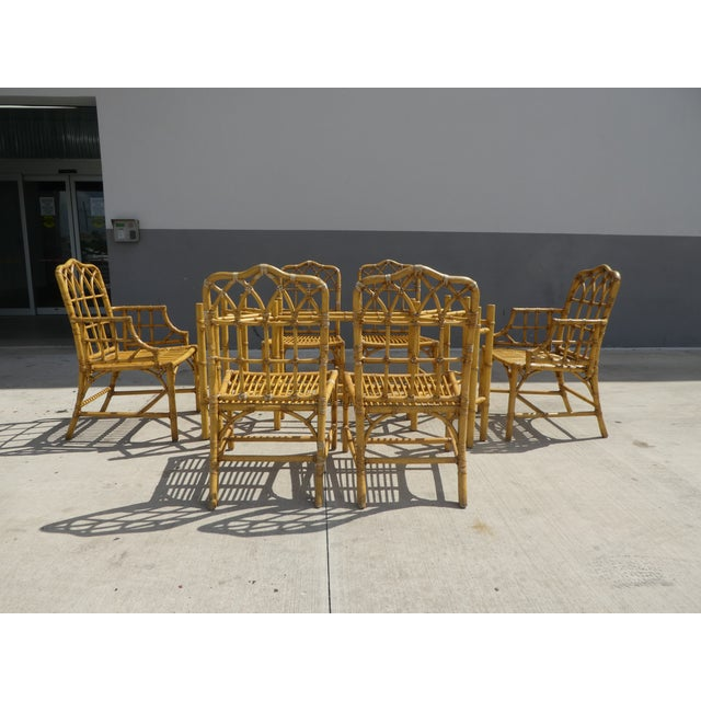 Chinese Chippendale Rattan Dining Room Table W 6 Pagoda Top Dining Chairs sold as found previously owned in good vintage...